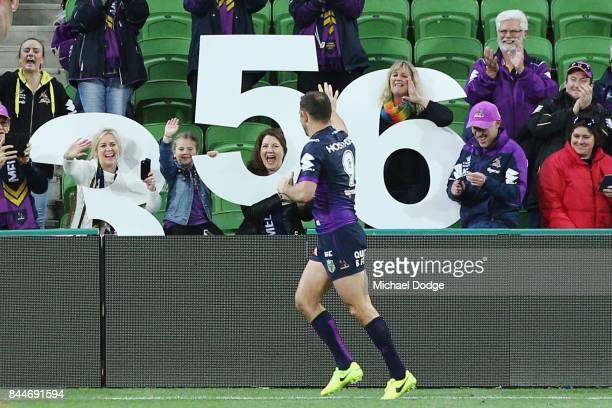 Cameron Smith of the Stormthanks fans after winning in his record 356th match during the NRL Qualifying Final match between the Melbourne Storm and...