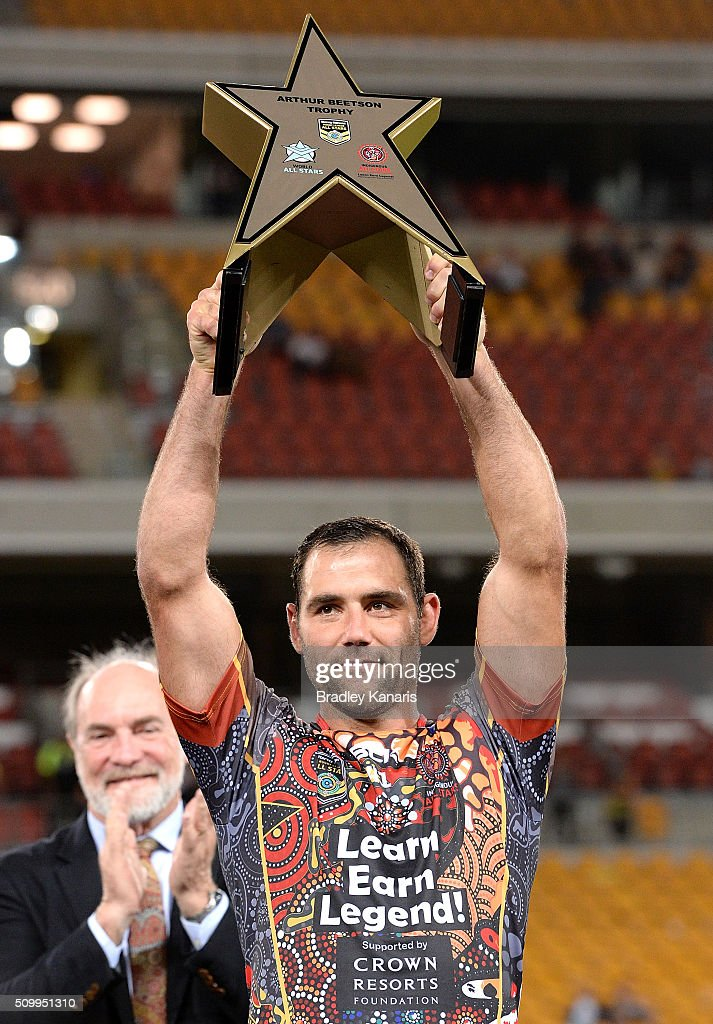 Cameron Smith of the World All Stars holds up the winners trophy after the NRL match between the Indigenous All-Stars and the World All-Stars at Suncorp Stadium on February 13, 2016 in Brisbane, Australia.