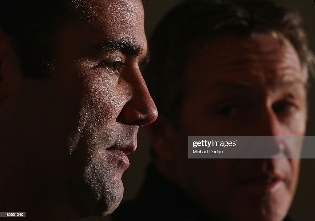 Cameron Smith, playing his 300th game on the weekend, reacts next to coach Craig Bellamy when speaking to the media during a Melbourne Storm NRL media opportunity at AAMI Park on July 14, 2015 in Melbourne, Australia.