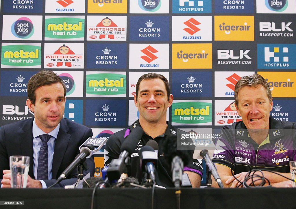 Cameron Smith, playing his 300th game on the weekend, reacts next to CEO Dave Donaghy (L) and coach Craig Bellamy when speaking to the media during a Melbourne Storm NRL media opportunity at AAMI Park on July 14, 2015 in Melbourne, Australia.