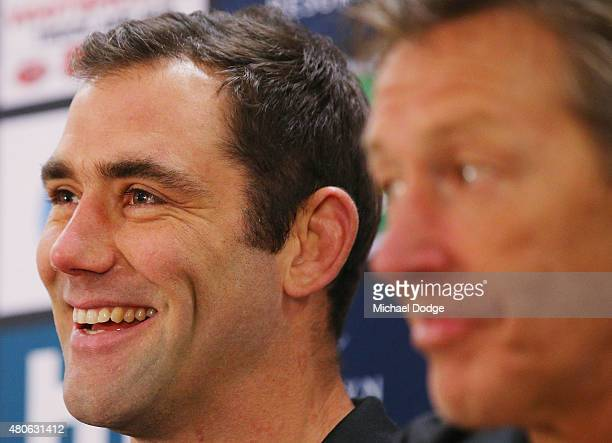 Cameron Smith playing his 300th game on the weekend reacts next to coach Craig Bellamy when speaking to the media during a Melbourne Storm NRL media...