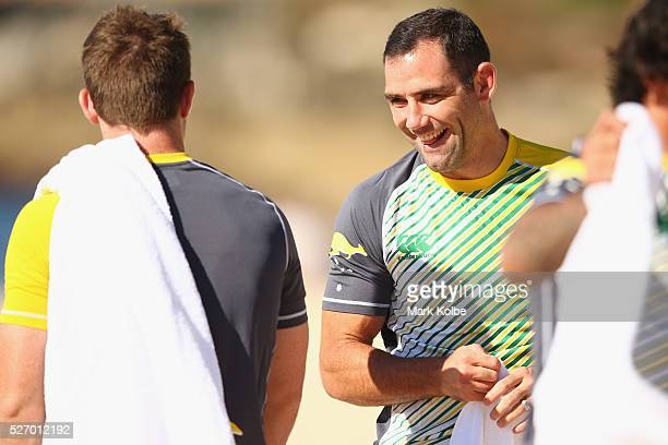 Cameron Smith shares a laugh with a team mate during the Australia Kangaroos Test team recovery session at Coogee Beach on May 2 2016 in Sydney...
