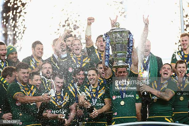 Cameron Smith the captain of Australia lifts the winners trophy after his sides 342 victory during the Rugby League World Cup Final between Australia...