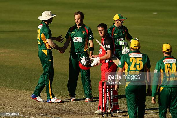 Cameron Stevenson of the Tigers celebrates with team mates after taking 5 wickets and victory during the Matador BBQs One Day Cup match between South...