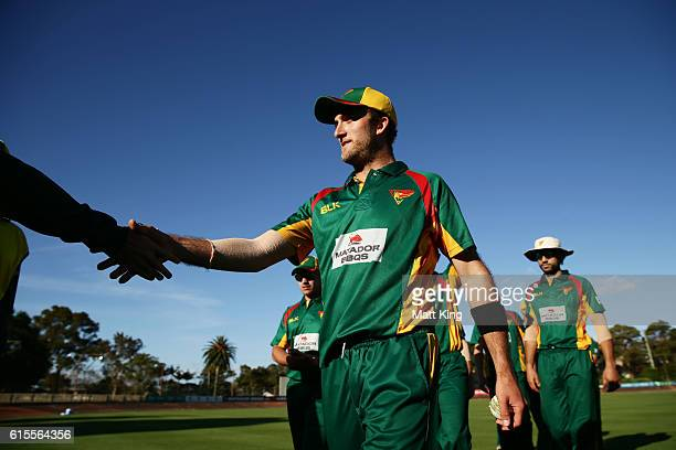 Cameron Stevenson of the Tigers leads the Tigers off the field after taking 5 wickets and victory during the Matador BBQs One Day Cup match between...