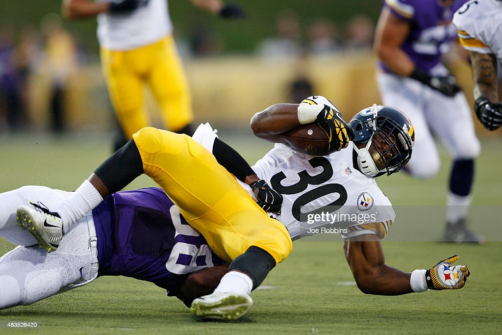 Cameron Stingily #30 of the Pittsburgh Steelers gets tackled for a loss of yardage against the Minnesota Vikings in the first half of the NFL Hall of Fame Game at Tom Benson Hall of Fame Stadium on August 9, 2015 in Canton, Ohio.
