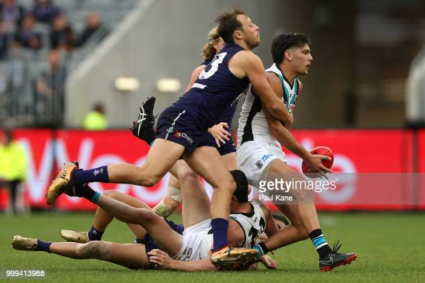Cameron Sutcliffe of the Dockers tackles Riley Bonner of the Power during the round 17 AFL match between the Fremantle Dockers and the Port Adelaide...