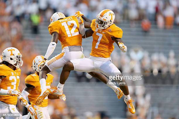 Cameron Sutton and Emmanuel Moseley of the Tennessee Volunteers celebrate after Moseley broke up a pass against the Oklahoma Sooners during the game...