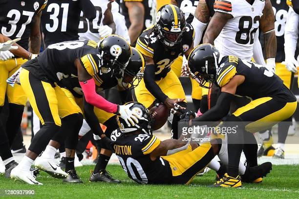 Cameron Sutton of the Pittsburgh Steelers celebrates with teammates after intercepting a pass intended for Rashard Higgins of the Cleveland Browns in...