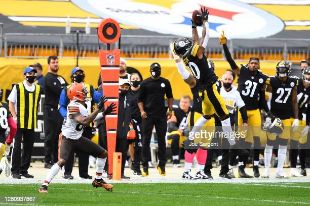 Cameron Sutton of the Pittsburgh Steelers intercepts a pass intended for Rashard Higgins of the Cleveland Browns in the second quarter of their NFL...