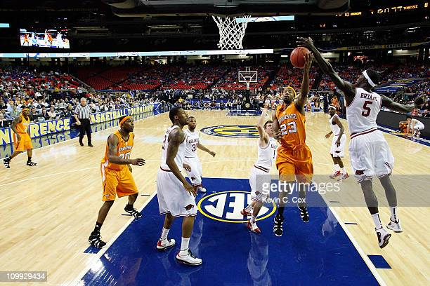 Cameron Tatum of the Tennessee Volunteers shoots against Glenn Bryant of the Arkansas Razorbacks during the first round of the SEC Men's Basketball...