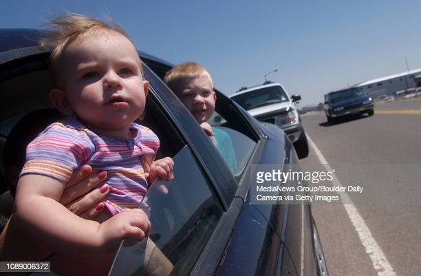 Cameron Toms front and her brother Nicholas watch slurry bombers reload fire retardant material and take off from Jefferson County Airport in...