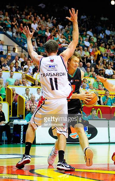 Cameron Toovey of the Crocodiles attempts to drive past Cameron Tragardh of the Hawks during game two of the NBL semi final series between the...