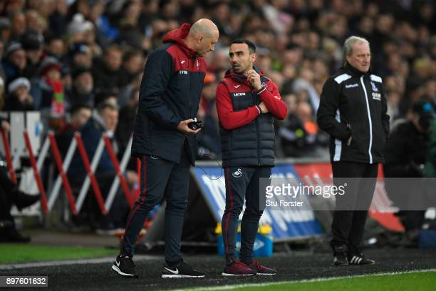 Cameron Toshack Swansea City coach speaks to Leon Britton Caretaker manager Player/Manager of Swansea City during the Premier League match between...