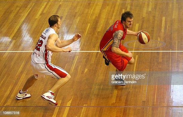 Cameron Tragardh of the Tigers dribbles past Tim Coenraad of the Hawks during the round 17 NBL match between the Melbourne Tigers and the Wollongong...