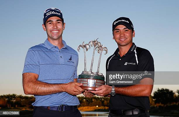 Cameron Tringale and Jason Day of Australia pose with the trophy after winning the Franklin Templeton Shootout at Tiburon Golf Club on December 13...