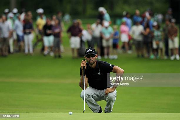 Cameron Tringale lines up a putt on the 18th green during the third round of The Barclays at The Ridgewood Country Club on August 23 2014 in Paramus...