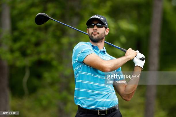 Cameron Tringale of the United States watches his tee shot on the thirteenth hole during round three of the Shell Houston Open at the Golf Club of...