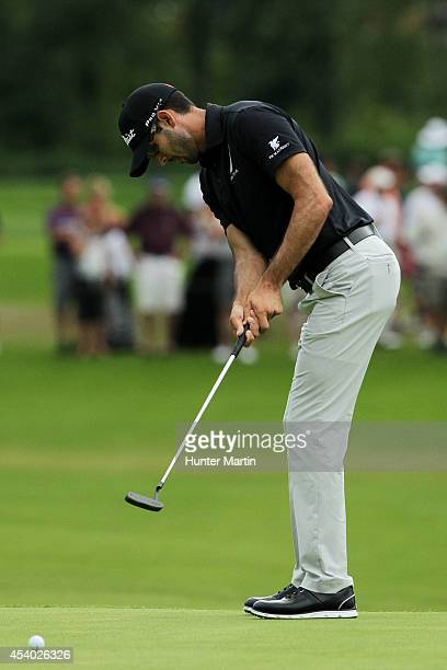 Cameron Tringale putts on the 18th green during the third round of The Barclays at The Ridgewood Country Club on August 23 2014 in Paramus New Jersey