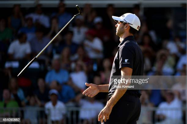 Cameron Tringale reacts after missing a putt on the 18th green during the final round of The Barclays at The Ridgewood Country Club on August 24 2014...