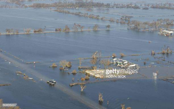 Cars travelling on flooded Route 82 in Cameron Parish along the Gulf Coast of Louisiana 01 October 2005 pass structures destructed by Hurricane Rita...