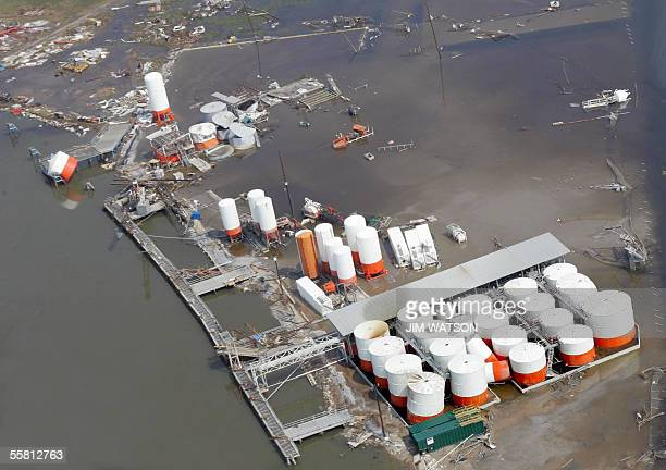 This aerial view shows a flooded and damaged oil storage facilty in Cameron LA 27 September 2005 after hurricane Rita hit the region US President...