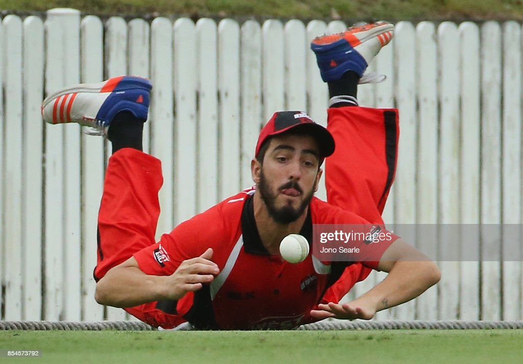 Cameron Valente of SA Fields the ball during the JLT One Day Cup match between South Australia and the Cricket Australia XI at Allan Border Field on September 27, 2017 in Brisbane, Australia.