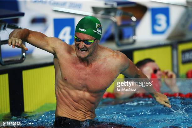 Cameron van der Burgh of South Africa celebrates after winning the Men's 100m Breaststroke on day five of the Gold Coast 2018 Commonwealth Games at...