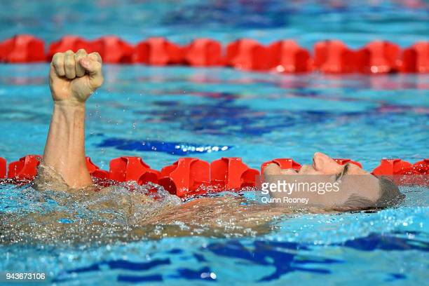 Cameron van der Burgh of South Africa celebrates victory in the Men's 50m Breaststroke Final on day five of the Gold Coast 2018 Commonwealth Games at...