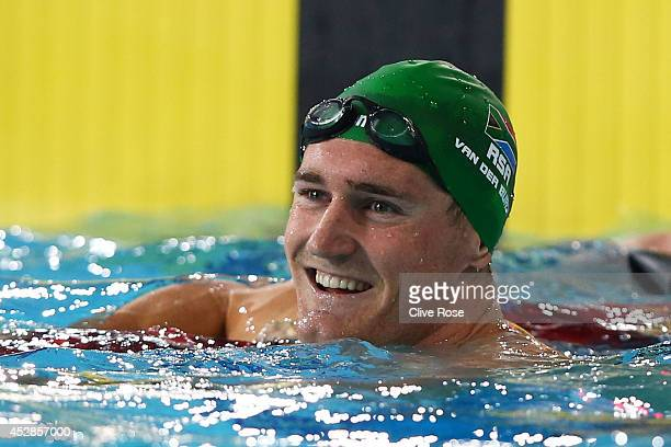 Cameron van der Burgh of South Africa celebrates winning the gold medal in the Men's 50m Breaststroke Final at Tollcross International Swimming...