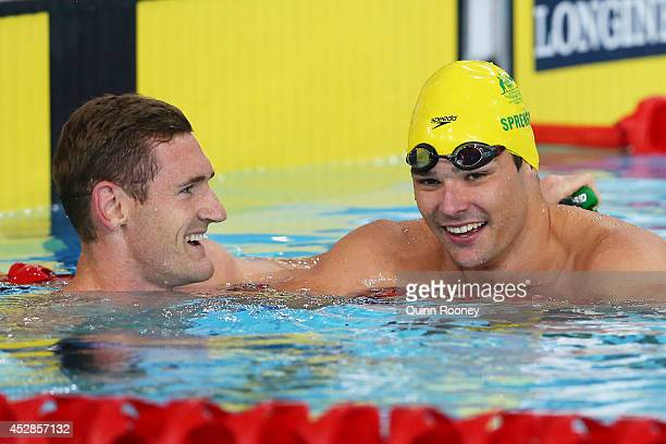 Cameron van der Burgh of South Africa celebrates winning the gold medal with bronze medallist Christian Sprenger of Australia in the Men's 50m...