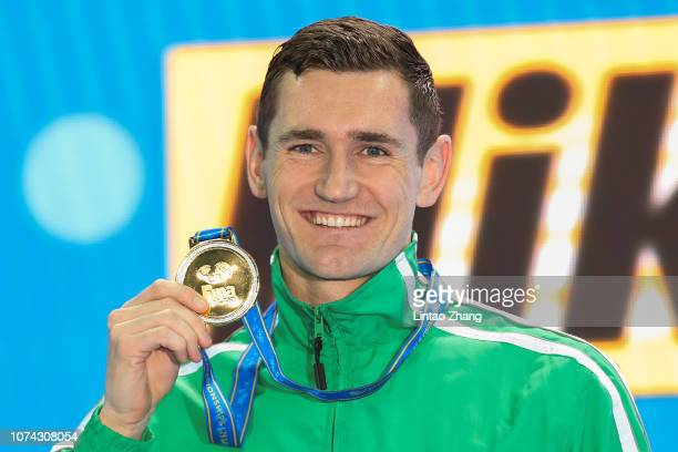 Cameron Van Der Burgh of South Africa poses with his gold medal after winning the Men's 50m Breaststroke Final on day 6 of the 14th FINA World...
