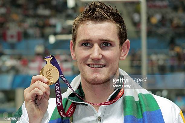 Cameron Van Der Burgh of South Africa poses with the gold medal during the medal ceremony for the Men's 100m Breaststroke Final at the Dr SP...