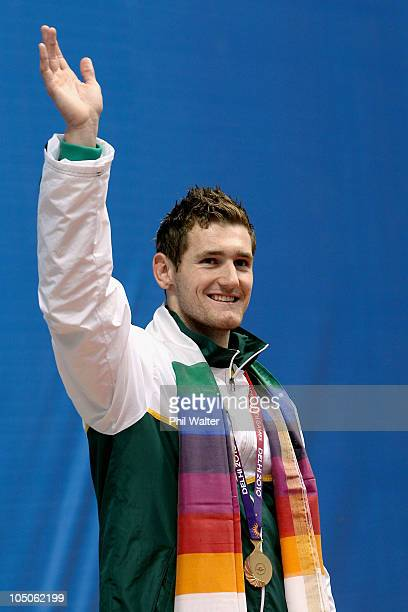 Cameron Van Der Burgh of South Africa poses with the gold medal during the medal ceremony for the Men's 50m Breaststroke Final at Dr SP Mukherjee...