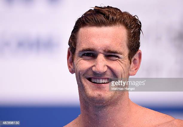 Cameron van der Burgh of South Africa smiles after setting a new world record in a time of 2662 in the Men's 50m Breaststroke heats on day eleven of...