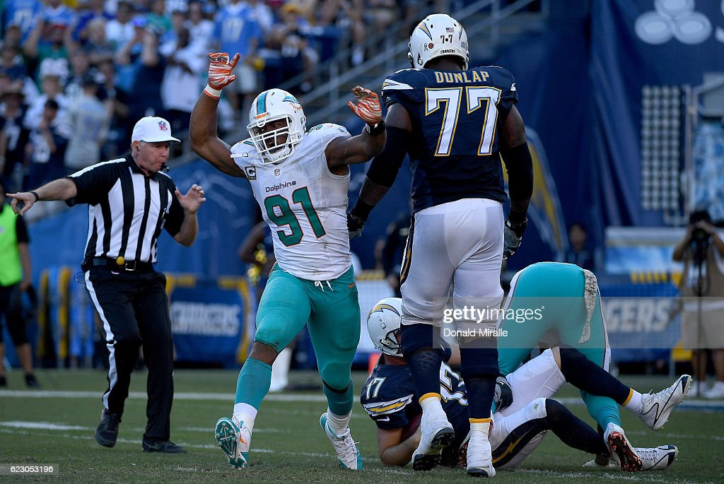 Cameron Wake #91 of the Miami Dolphins celebrates his tackle of quarterback Philip Rivers #17 of the San Diego Chargers during the 2nd half of the Miami Dolphins v San Diego Chargers NFL Game at Qualcomm Stadium on November 13, 2016 in San Diego, California.