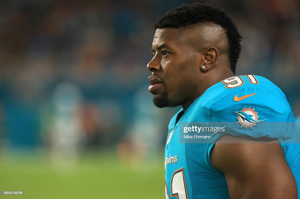 Cameron Wake #91 of the Miami Dolphins looks on during a preseason game against the Baltimore Ravens at Hard Rock Stadium on August 17, 2017 in Miami Gardens, Florida.