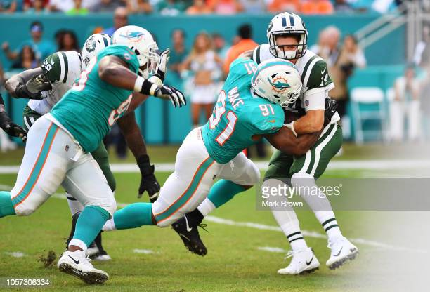 Cameron Wake of the Miami Dolphins sacks Sam Darnold of the New York Jets in the second quarter of their game at Hard Rock Stadium on November 4,...