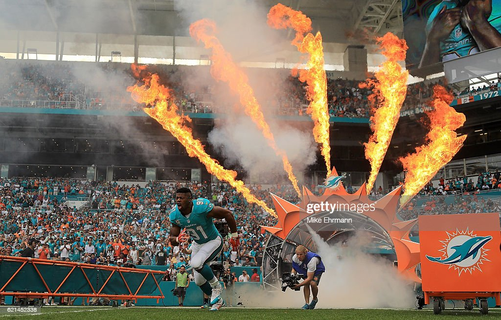 Cameron Wake #91 of the Miami Dolphins takes the field during a game against the New York Jets at Hard Rock Stadium on November 6, 2016 in Miami Gardens, Florida.