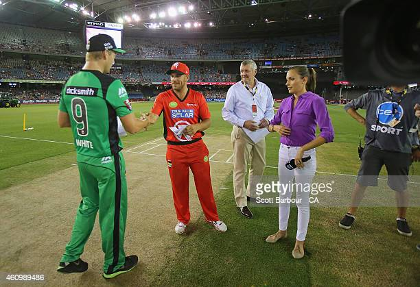 Cameron White captain of the Stars shakes hands with Aaron Finch captain of the Renegades as Channel Ten presenter Roz Kelly looks on before the coin...