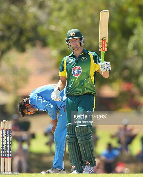 Cameron White of Australia 'A' celebrates as he reaches his century during the Cricket Australia Quadrangular Series Final match between Australia...
