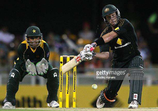 Cameron White of Australia hits the ball over the boundary for his second of three sixes in a row during the first One Day International match...