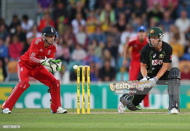 Cameron White of Australia reverse sweeps during game one of the International Twenty20 series between Australia and England at Blundstone Arena on...