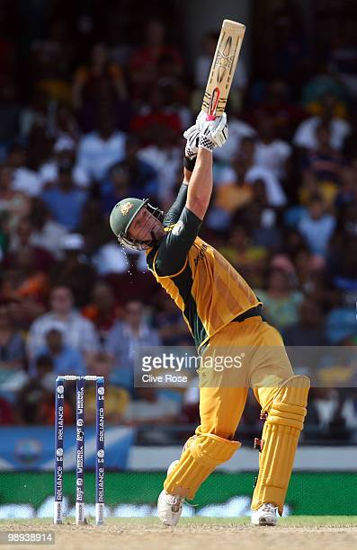 Cameron White of Australia smashes a six during the ICC World Twenty20 Super Eight match between Sri Lanka and Australia at the Kensington Oval on...