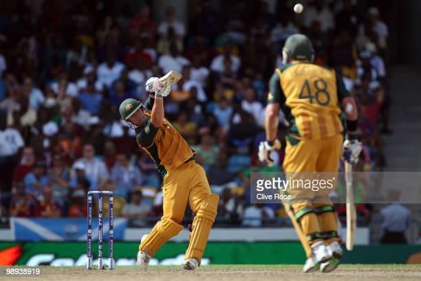 Cameron White of Australia smashes a six during the ICC World Twenty20 Super Eight match between Sri Lanka and Australia at the Kensington Oval on...