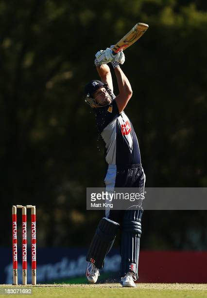 Cameron White of the Bushrangers hits for six during the Ryobi Cup match between the South Australia Redbacks and the Victoria Bushrangers at...
