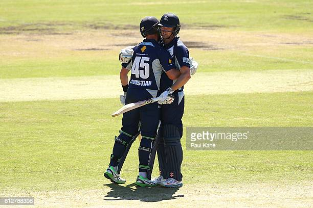 Cameron White of the Bushrangers is congratulated by Dan Christian of the Bushrangers after scoring his century during the Matador BBQs One Day Cup...