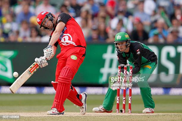 Cameron White of the Melbourne Renegades hits Adam Zampa of the Melbourne Stars for 6 during the Big Bash League match between the Melbourne Stars...