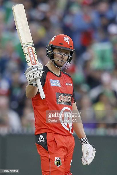 Cameron White of the Melbourne Renegades raises his bat after scoring 50 runs during the Big Bash League match between the Melbourne Stars and...
