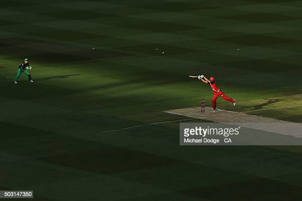 Cameron White of the Renegades hits the ball over Tom Triffit of the Stars to bring up his half century during the Big Bash League match between the...